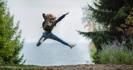 Girl jumping into the air