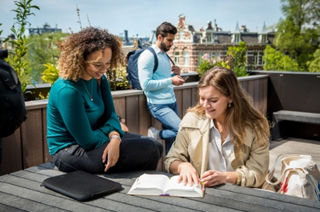 Two female law students out on the terrace